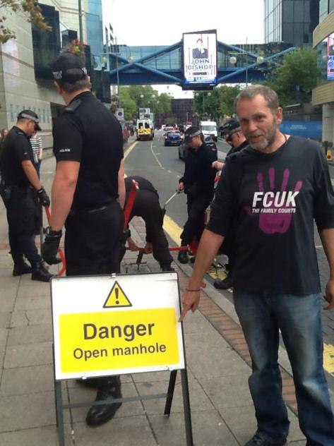 ....Holes!!Martin Matthews outside the Conservative Party conference in Birmingham