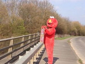 Elmo Protesting on Bridge