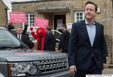 Prime Minister David Cameron leaves after casting their votes at Spelsbury Memorial Hall, Witney, as Britain goes to the ballot box today in the most uncertain General Election for decades, with no party on course to emerge a clear winner.