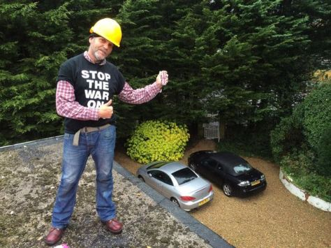 Martin Matthews on the roof of MP Chris Grayling's home on Wednesday October 21